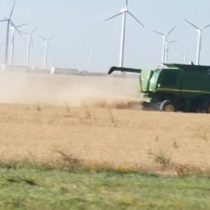 Tractor in Texas with Wind Turbine